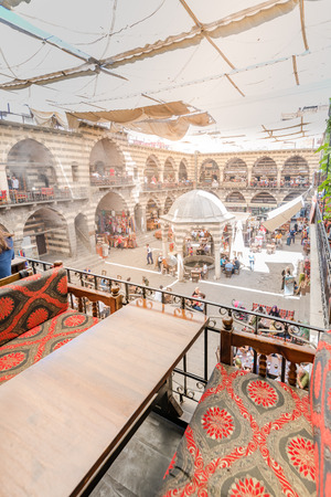 View of courtyard of Hasan Pasha Khan,a medieval inn used for cafes and small shops now in Diyarbakir,Turkey Editöryel