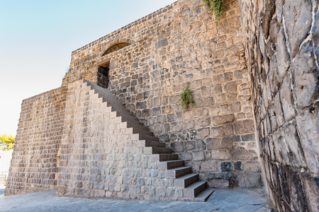 Ancient walls of Historical gate named as Mardin gate in sur region in central of Diyarbakir,Turkey. Editorial