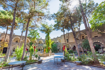Courtyard of Deliller Han Madrassah Khan,a medieval inn used for a hotel now in Diyarbakir,Turkey.16 July 2018 Editöryel