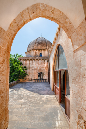 Gate and courtyard of Hamidiye Mosque(Seyh Zebuni)built in 1347 and locates in Mardin,Turkey.17 June 2018