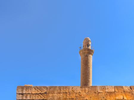 Minaret of Melik Mahmut Mosque(Bab Es Sur)built in 1368 and locates in Mardin,Turkey.17 June 2018