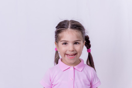 Portrait of cute little happy girl in school uniform.Selective focus and small depth of field.