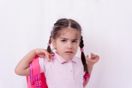 Portrait of cute unhappy and sad girl in school uniform not want to go school.Copy space for editing. Foto de archivo