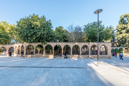 Unidentified people walk at courtyard of Balikli Gol(fish lake) in Sanliurfa city center.Sanliurfa,Turkey.18 July 2018 Sajtókép
