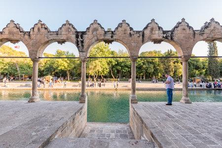 Unidentified people visit Halil-Ur Rahman Lake or named Balikli Gol(fish lake) in Sanliurfa,Turkey.18 July 2018