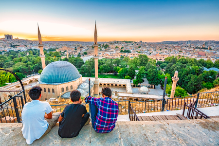 Unidentified people look over Mevlidi Halil Mosque,one of landmarks in Sanliurfa,Turkey.18 July 2018 Editöryel
