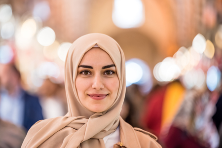 Portrait of beautiful Muslim woman in headscarf and fashionable modern clothes looking at camera.Modern Muslim women lifestyle business or travel tourist concept 版權商用圖片
