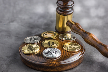Different cryptocurrencies and gavel over gavel wooden board.Concept image for cryptocurrency Imagens - 122817315