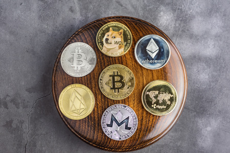 Different cryptocurrencies over gavel wooden board.Concept image for cryptocurrency Imagens - 122817318