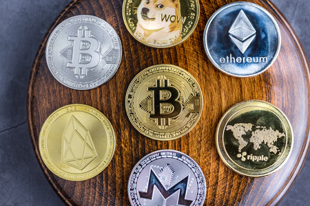 Different cryptocurrencies over gavel wooden board.Concept image for cryptocurrency Imagens
