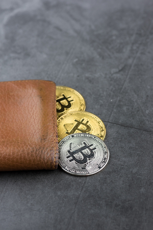 View of metal bitcoins in brown leather wallet.Concept image for cryptocurrency 写真素材