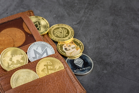 View of different kind of metal bitcoins in brown leather wallet.Concept image for cryptocurrency Imagens - 122817333
