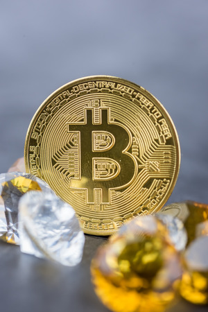 View of metal bitcoins surrounded with diamonds.Concept image for cryptocurrency