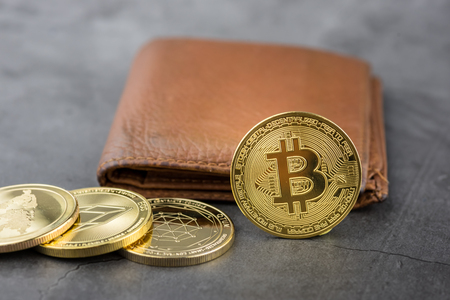 View of metal bitcoins near brown leather wallet.Concept image for cryptocurrency Imagens - 122817434
