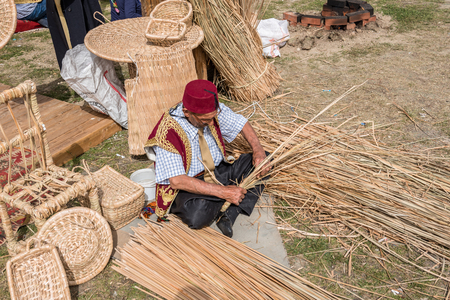 Unidentified man makes a traditional wicker basket. ISTANBUL, TURKEY,MAY 13,2017