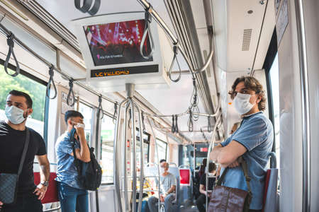 Unidentified Turkish people wear mask while transporting at tramway train in Istanbul,Turkey :16 June 2020