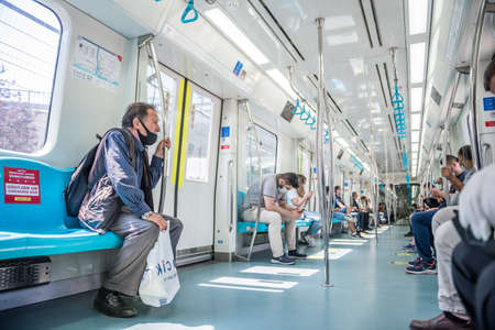 Unidentified Turkish people wear masks to protect against covid-19 for social distancing policy while transporting at Marmaray train in Istanbul,Turkey :16 June 2020 Editöryel