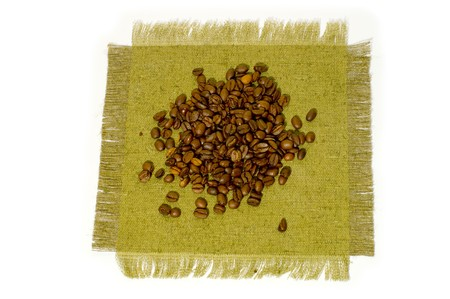 coffeebeans: Coffee-beans on canvas, close up.