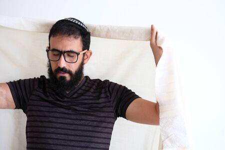 Bearded Jewish Man using a Talith (talis) Before praying