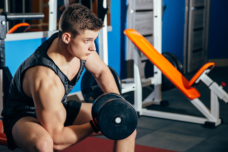 Male athlete with dumbbell during a workout