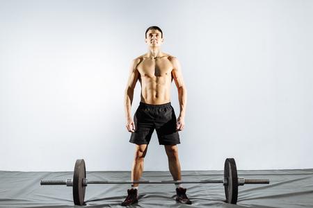 Muscular man preparing to do deadlift Stock Photo