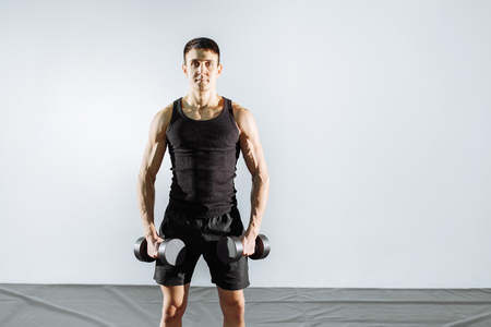 Fit Athlete Working Out Biceps at the gym. Stock Photo
