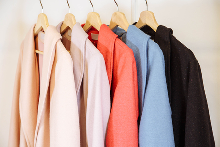 Mix color row of female coats on hangers Banque d'images