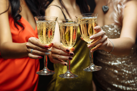 Hands holding the glasses of champagne making a toast Stock Photo