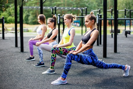 Sporty cheerful women doing sport activities outdoors