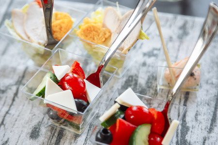 Fresh salad with cheese and tomato in a glass. Catering Reklamní fotografie