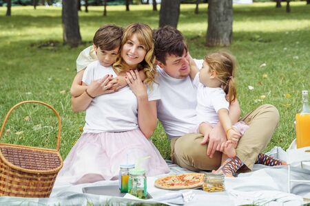 Portrait of a happy family on a picnic on a sunny summer day. 版權商用圖片