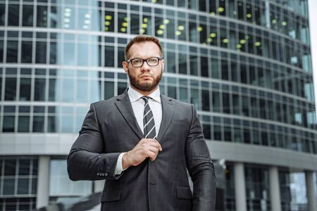 Portrait of a serious business man in a suit and glasses