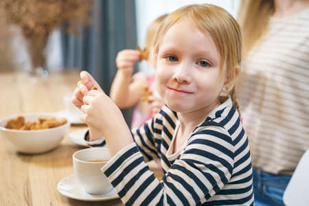 Portrait of a cute little girl in the kitchen.
