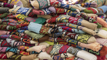 winter fashion: Group of handmade colorful knitted socks in the market