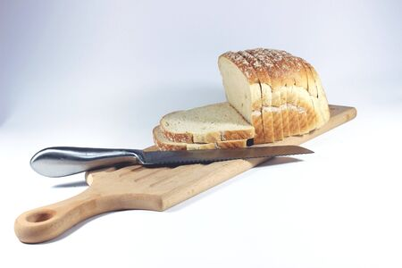 loafer: Sliced ??bread on the cutting board with the knife