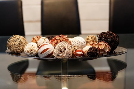 shallow depth of field: Beautifully Crafted Potpourri Balls on Plate