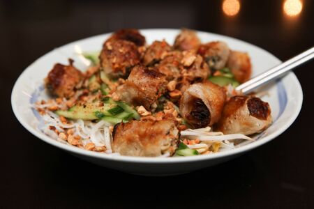 vietnamese food: Fried Spring Rolls Vermicelli Low Angle Stock Photo