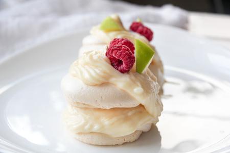 Pavlova meringue cake with custard and fresh berries Stock Photo