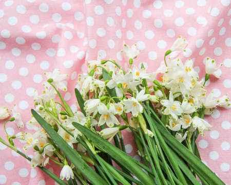 first fresh spring flowers are white bells bouquet wrapped in paper