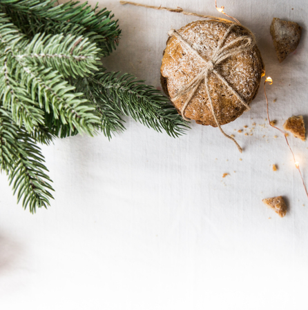 Homemade cookies on a white tablecloth,Christmas tree branches and Christmas lights Stock Photo
