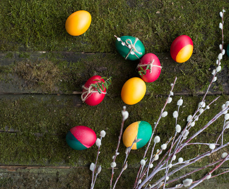 decorated Easter eggs on wooden background