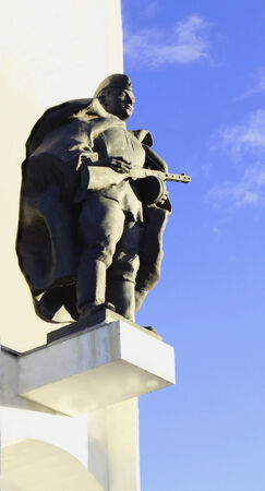 collisions: The monument to the soldier on a high pedestal on the background of blue sky