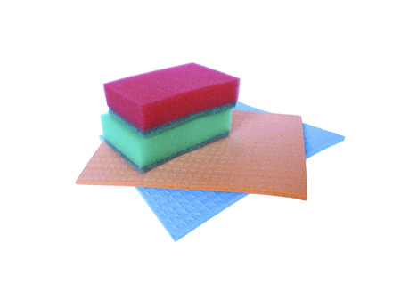 daily use item: Two colorful sponges for washing dishes lie on two differently colored napkins for household cleaning