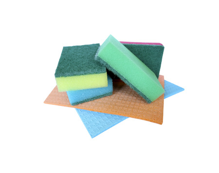 daily use item: Several colorful sponges for washing dishes lie on colored napkins for cleaning