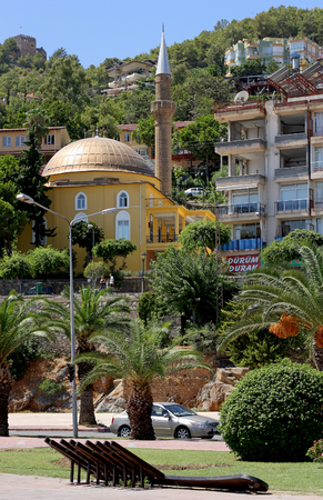 squatter: Alanya,Turkey - August 28, 2015:the Living area with a mosque in Alanya on the mountain. The area is surrounded by palm trees. Editorial