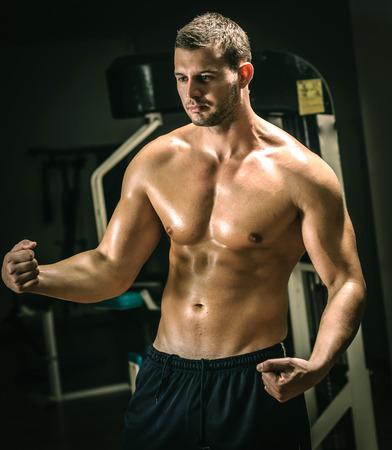 Man posing in gym