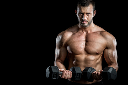 Young adult man doing barbell press in gym photo