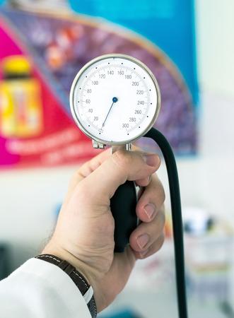 Using sphygmomanometer - blood pressure measurement device. photo