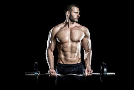weight lifting: Man doing weight lifting in gym on black background. Stock Photo