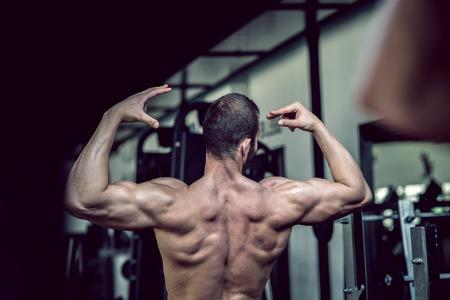 latissimus: Man showing back in gym